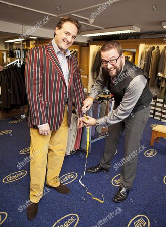 Daily Mail Feature Writer Guy Walters Is Measured By Richard Cole One Of The Owners Of The Famous Gentleman's Outfitters In Cheltenham Which Is Closing Down After 126 Years.