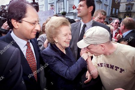 A FAN KISSES THE HAND OF LADY MARGARET THATCHER WHILE SHE IS CAMPAIGNING FOR THE GENERAL ELECTION WITH CANDIDATE SHAILESH VARA