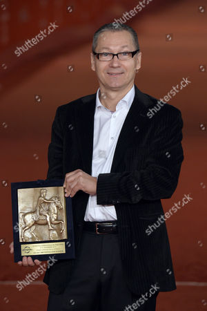 Stock Photo of Tayfun Pirselimoglu with an award for best screenplay