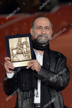 Stock Image of Tayfun Pirselimoglu with an award for best screenplay