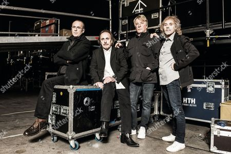 Stock Picture of Status Quo - Francis Rossi, John Coghlan, Rick Parfitt and Alan Lancaster backstage before a live performance at Wembley Arena, London