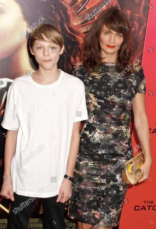 Stock Picture of Helena Christensen with son Mingus Lucien Reedus