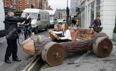 Stock Photo of The Showbiz Car Auction Of The Year One Of The Cars In The Auction Fred Flintstones 1994 Driven By 22 Year Old Dominque Mastalan And In The Passenger Seat 17 Year Old Anastasia Creeghan-starr Pushing The Car Louisa Skipper. The Car Is Expected To Fetch Around 8 To 10 Thousand Pounds..