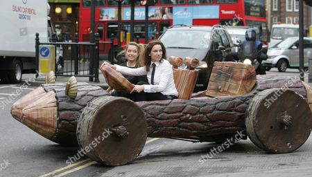 Editorial picture of The Showbiz Car Auction Of The Year One Of The Cars In The Auction Fred Flintstones 1994 Driven By 22 Year Old Dominque Mastalan And In The Passenger Seat 17 Year Old Anastasia Creeghan-starr Pushing The Car Louisa Skipper. The Car Is Expected To Fet