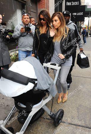 La La Anthony and Kim Kardashian West with North West
