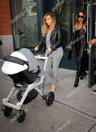 Stock Picture of Kim Kardashian West and La La Anthony with North West