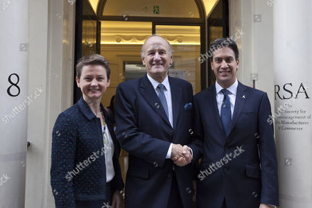 The shadow home secretary Yvette Cooper (L), former chief commissioner of the Metropolitan Police Service Sir John Stevens (C) and Labour leader Ed Miliband (R)