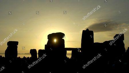 Stock Image of THE SUNRISE OVER STONEHENGE ON SUMMER SOLSTICE