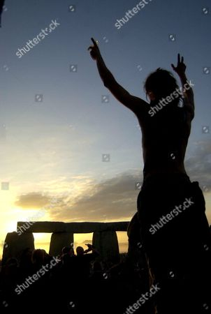 Stock Picture of CELEBRATIONS DURING THE SUNRISE OVER STONEHENGE ON SUMMER SOLSTICE