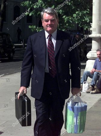 DAVID IRVING ARRIVING AT THE HIGH COURT WHERE HE IS APPEALING AGAINST A DEFEAT IN HIS LIBEL CASE AGAINST THE AUTHOR DEBORAH LIPSTADT