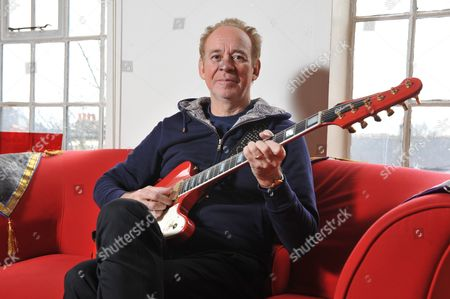 London, Britain. Portrait Of English Musician And Producer Phil Manzanera Posing With His Signature Gibson Firebird V11