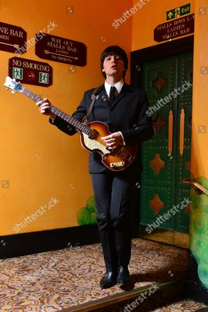 London, Britain. Italian Musician Emanuele Angeletti Dressed As Paul Mccartney As Part Of The Let It Be Musical At The Savoy Theatre In London February 22