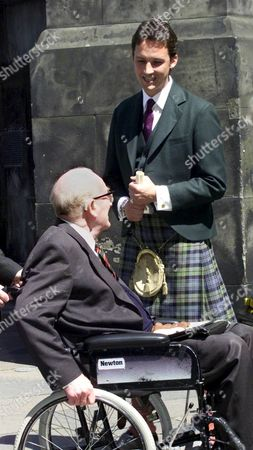 THE DUKE OF BUCCLEUCH (IN WHEEL CHAIR) WITH THE 13TH DUKE OF ARGYLL.