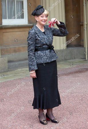 Stock Photo of Broadcaster Kay Alexander with her MBE