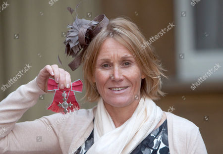 Stock Photo of Director of Sport for the Paralympic Association Penny Briscoe with her MBE