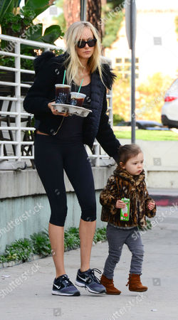 Kimberly Stewart getting iced coffee while daughter Delilah Del Toro gets an apple juice
