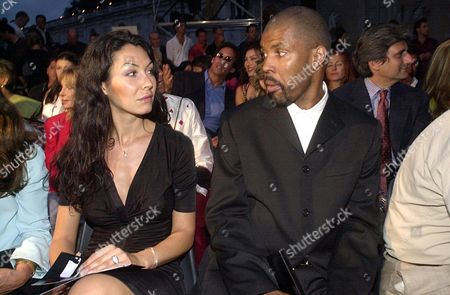 Stock Picture of ERIQ LA SALLE IN THE AUDIENCE WITH MODEL YASMINE