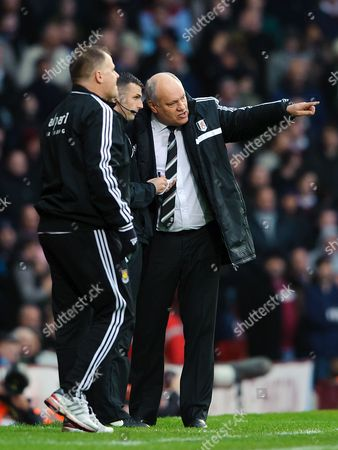 Fulham manager Martin Jol talks to the 4th official