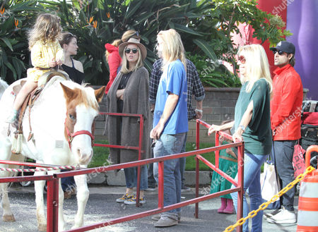 Jason Schwartzman, Brady Cunningham, with daughter Marlowe