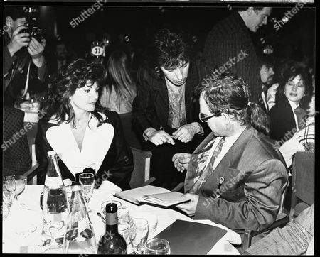 Rolling Stone Bill Wyman Is Pictured Asking Elton John For His Autograph In April 1986. Elton Is Sat With His Wife Renate Blauel (divorced 1987) 7/4/86.