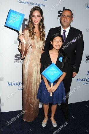 Stock Photo of Emina Cunmulaj, Sam Nazarian and guest