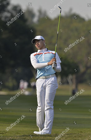 Guan Tianlang plays his 2nd shot to the 13th in The Hong Kong Open Golf