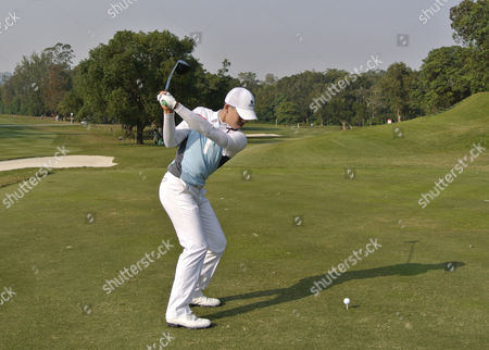 Stock Photo of Guan Tianlang of China plays his tee shot on the 14th in The Hong Kong Open Golf