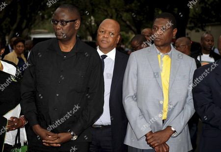 Former Secretary General of COSATU Zwelenzima Vavi, Minister of Justice Jeff Radebe and Minister of Arts and Culture Paul Mashatile outside the Mandela Houghton home