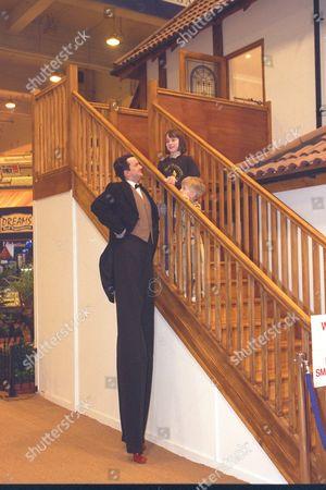 Lisa Chandler And Brother Bradley Chandler At Ideal Home Exhibition Next To 'world's Tallest Man' (performer On Stilts) Richard Gauntlett 1997.