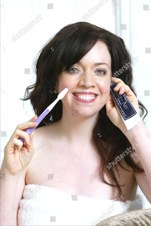 Journalist Erin Kelly Is Pictured With A Toothbrush And Diet Aid Toothpaste. The Toothpaste Claims To Act As An Appetite Suppressant And Is Meant To Be Used 5 Times A Day. Kelly Tested The Product For A Daily Mail Feature. She Found It To Be No Different From Any Other Toothpaste.