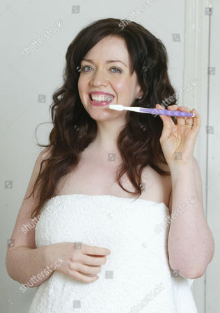 Journalist Erin Kelly Is Pictured With A Toothbrush And Diet Aid Toothpaste. The Toothpaste Claims To Act As An Appetite Suppressant And Is Meant To Be Used 5 Times A Day. Kelly Tested The Product For A Daily Mail Feature. She Found It To Be No Different From Any Other Toothpaste. Www.dietaidonline.com.