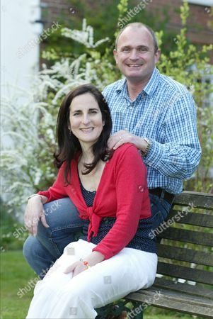 Charles Ingram And Diana Ingram At Their Wiltshire Home Following The Salisbury Court Case Where Charles Ingram Was Found Guilty Of Common Assault After Lashing Out When A 13-year-old Local Youth Aimed A 'wet Cough' In His Face. It Was Coughing Of Course That Earned Him His Notoriety In The First Place Specifically The Elaborate Scam In Which An Accomplice In The Audience Of The Itv Quiz Show Who Wants To Be A Millionaire? Helped Ingram To The Ii1million Prize By Clearing His Throat To Indicate Which Answers He Should Give. A Gripping Court Case In 2003 Led To A Conviction For Fraud Major Ingram Being Thrown Out Of The Army And Finally Bankrupt. Charles And Diana Ingram At Their Wiltshire Home Following Salisbury Court Case.