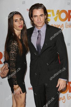 Stock Photo of Dermot Mulroney and Tharita Catulle