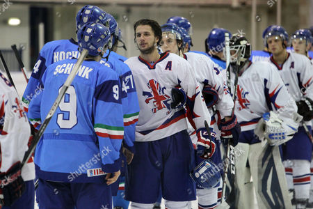 Liam Stewart shakes hands with Italy players after the game
