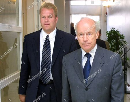 Stock Picture of Sonera Corporation's new President Harri Koponen (starting Oct. 1, 2001) he leaves the Swedish telecommunications company Ericsson to join Finnish Sonera with Chairman of the Board Tapio Hintikka (R)