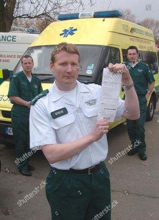 Harley Street Ambulance Service Operations Manager Steve Fleming (white Shirt) With Emergency Medical Technician (and Driver) Jason Eldridge (left) And One Of The Westminster Parking Tickets With Fellow Emt Charles Weeks Bell (right) .
