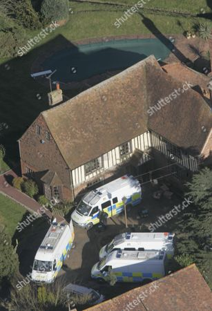Police Load Boxes From The Main House At The Kent Farm Belonging To Millionaire Crook John Fowler Which They Are Searching In Connection With The 53m Heist.this Was Britain's Biggest Ever Cash Robbery Of More Than Ii53 Million Which Took Place On Wednesday February 22 2006 Following A Raid On The Securitas Cash Depot In Tonbridge Kent.
