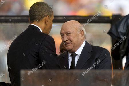 President Barack Obama and F W de Klerk attending Nelson Mandela's public Memorial Service.