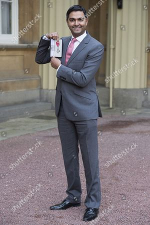 Stock Photo of Mr Wasim KhaN, receives an OBE for services to cricket and the community