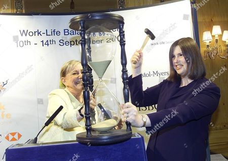 Nicola Horlick pretends to smash the Life-work Hour glass, assisted by Shirley Conran Chairman of Trustees