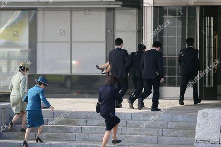 Stock Photo of Princess Yoko is carried away after fainting