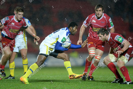 Scarlets v Clermont Auvergne - Heineken Cup - Noa Nakaitaci of Clermont Auvergne is tackled by Richard Kelly of Scarlets