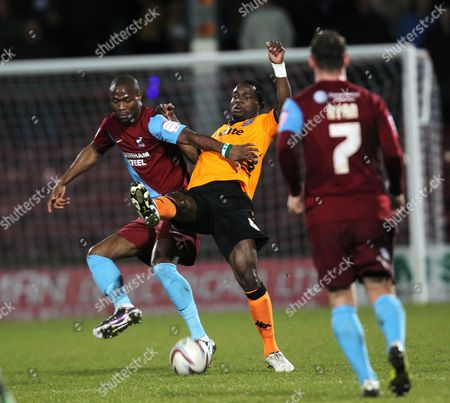Stock Photo of Portsmouth's Sam Sodje battles with brother Akpo Sodje of Scunthorpe