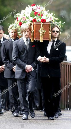 Crispian Mills (l) And Ace Lawson Carry The Coffin. Funeral Of Sir John Mills At The Parish Church Of St Mary The Virgin Denham Bucks.