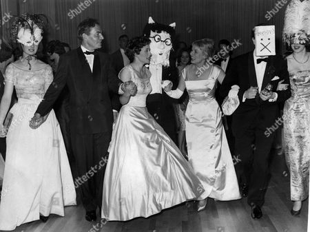 Actress Ann Todd And James Mason Join In A Palais Slide After Choosing The Winning Masks A The League Of Pity Ball At A Mayfair Hotel.