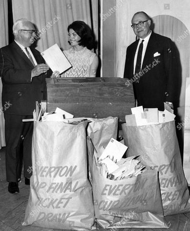 Stock Photo of Sheila Forrest Model Drawing The Lucky Letters For Who Will Receive A Cup Final Ticket Watched By Everton Chairman Jack Sharp Left And Director George Watts.