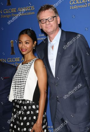 Zoe Saldana and Hollywood Foreign Press Association President Theo Kingma
