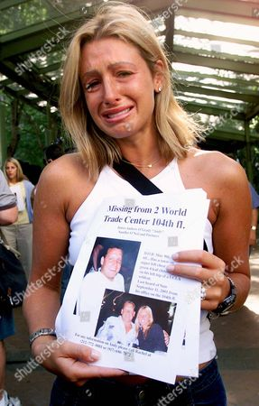 Rachel Uchitel holds a photo of her fiance Andy O'Grady, outside of Bellevue Hospital, missing since the explosions and collapse of the World Trade Center.