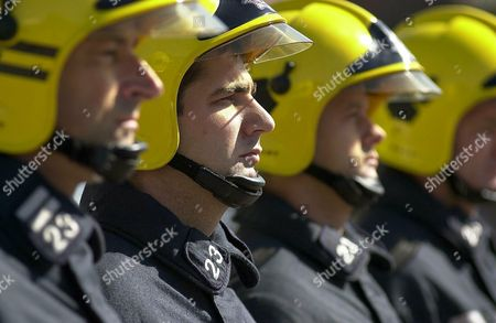 Stock Image of Firefighter Simon Stacey (28) based at Cosham fire station together with his fellow firefighters including (left) Sub-officer Peter Watson observe 3 minutes silence out of respect of the disaster in the United States