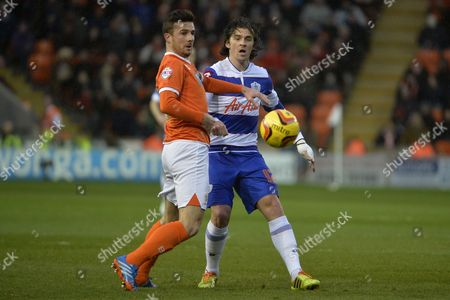 Joey Barton of QPRcompetes with Blackpool's Barry Ferguson